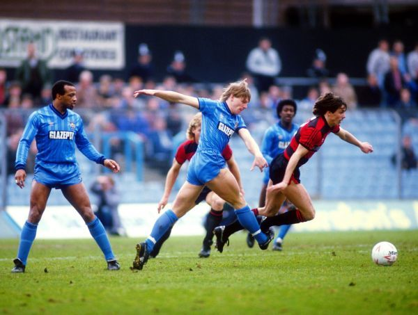 Coventry City's Stuart Pearce (c) ruthlessly hacks down a Queens Park Rangers forward