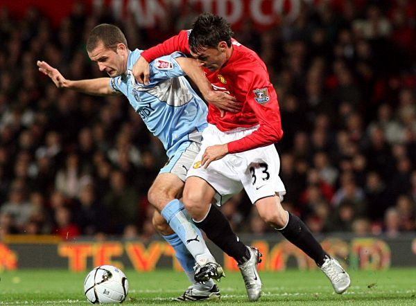 Manchester United's Chris Eagles (right) and Coventry City's Michael Doyle battle for the ball