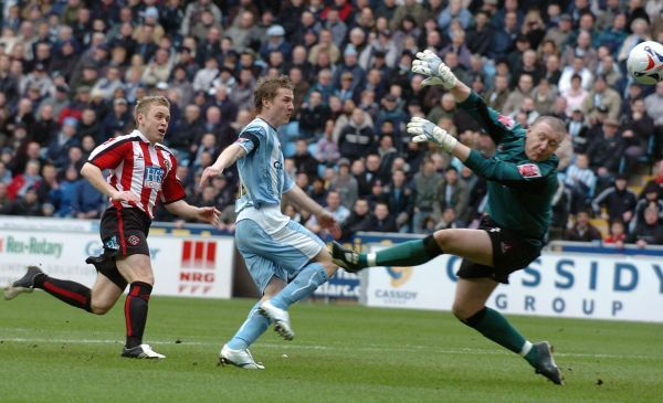 Coventry City's Gary McSheffery (C) scores against Sheffield United during the Coca-Cola Championship match at Highfield Road Stadium