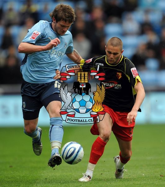 Coventry City's Aron Gunnarsson (left) and Watford's Henri Lansbury battle for the ball
