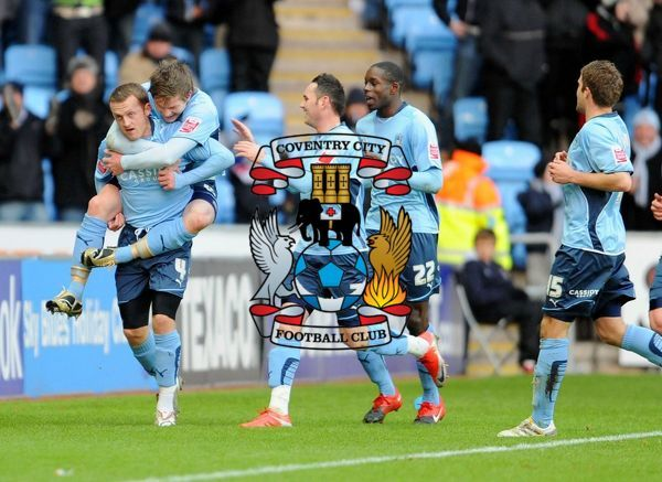 Coventry's Sammy Clingan (left) celebrates with his team-mates after scoring their second goal during the Coca-Cola Championship match at The Ricoh Arena, Coventry