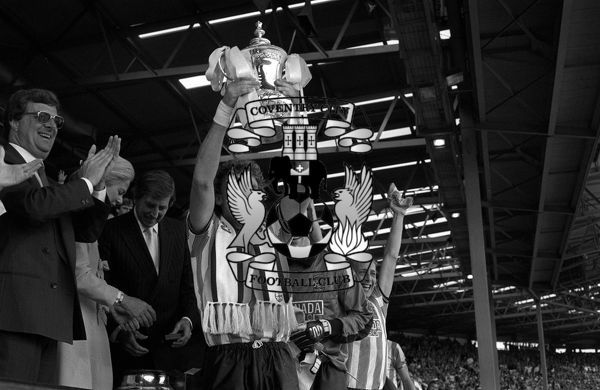 PA Photos 16.5.87 Triumphant Coventry City captain Brian Kilcline holds the coveted FA Cup football Trophy aloft after beating Tottenham Hotspur 3-2 in the Final, at Wembley in London