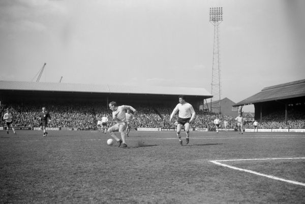 Maurice Setters, Coventry City half back, gets the ball from Johnny Byrne of Fulham