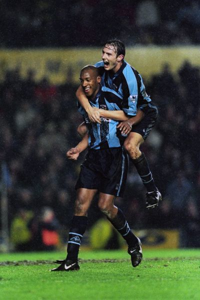 Noel Whelan and Dion Dublin celebrate during their FA Carling Premiership encounter with Manchester United at Highfield Road