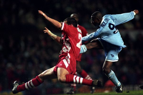 Peter Ndlovu, Coventry City, fires his hat trick goal against Liverpool past defender Neil Ruddock