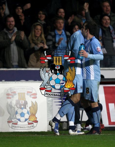 Coventry City's Leon Best celebrates with teammate Michael Doyle (right) in front of the City fans after scoring his sides first goal of the game