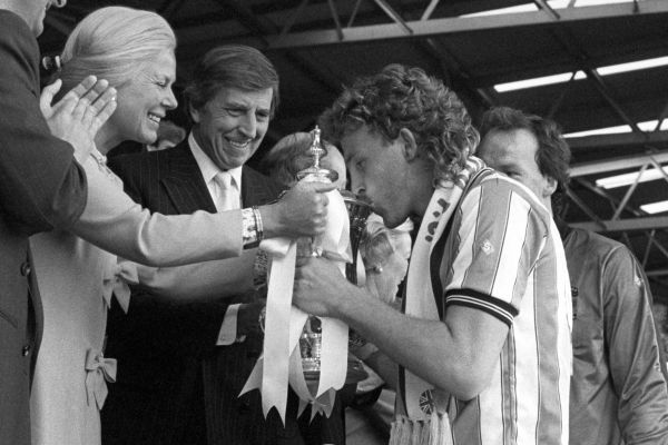 Coventry City captain Brian Kilcline kisses the FA Cup as the Duchess of Kent hands it over. Coventry City won the match 3-2 after extra time