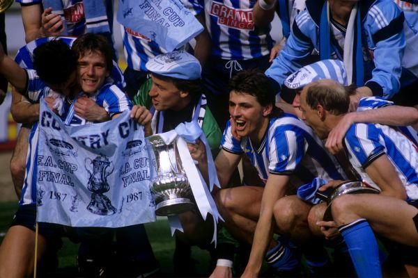 Coventry City celebrate with the FA Cup, left to right, David Phillips, goalkeeper Steve Ogrizovic, Nick Pickering, Graham Rodger (obscured) and Greg Downs