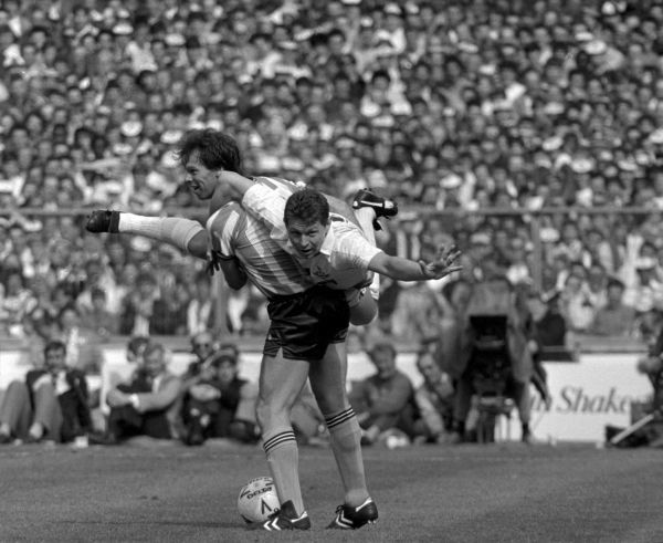 In a mischievous moment during the thrilling FA Cup Final at Wembley, Coventry City's Trevor Peake decides the only way to stop Tottenham Hotspurs goal machine Clive Allen is to carry him off