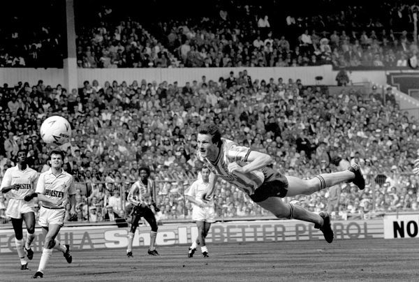 Coventry City's Keith Houchen (r) dives full length to head his team's second equalizing goal