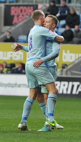 Coventry City's Gary McSheffrey is congratulated by Carl Baker after scoring his team's first goal during the FA Cup, Second Round match at the Ricoh Arena, Coventry