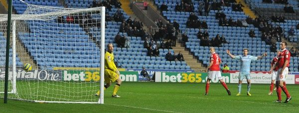 Coventry City's Carl Baker's long range shot hits the back of the net for his sides second goal during the FA Cup, Second Round match at the Ricoh Arena, Coventry