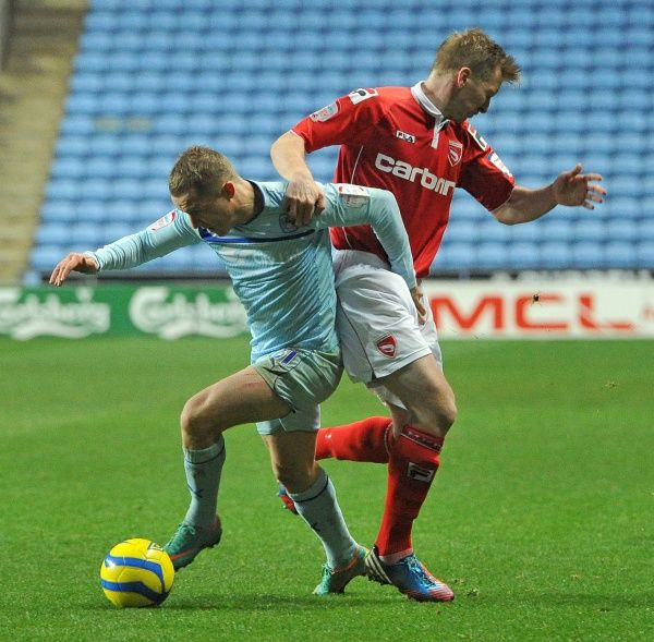 Coventry City's Gary McSheffrey (left) and Morecambe's Andrew Wright battle for the ball during the FA Cup, Second Round match at the Ricoh Arena, Coventry