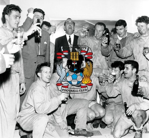 Coventry City players and officials, including manager Jimmy Hill (second l) and captain George Curtis (holding Player of the Season trophy, c), celebrate winning the Third Division Championship after their 1-0 victory