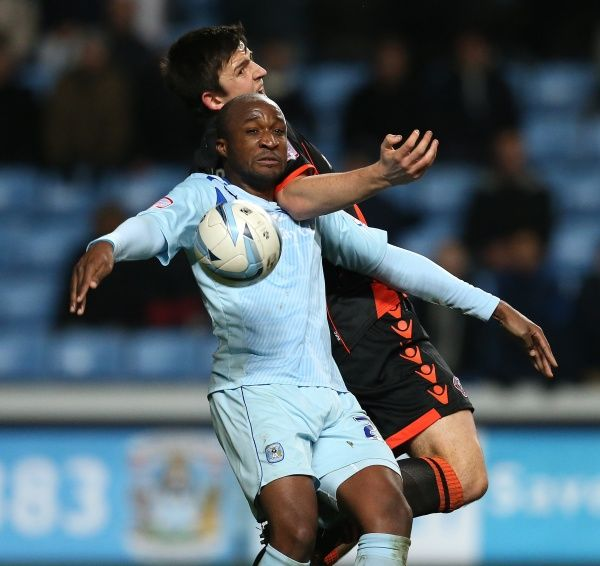 Coventry City's William Edjenguele and Sheffield United's Harry Maguire