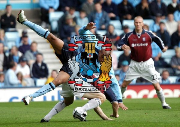 Coventry City's Jay Bothroyd (front) is tackled by an Ipswich defender during their Nationwide Division One match at Coventry's Highfield Road Stadium