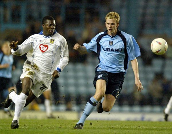 Portsmouth striker Yakubu (left) chases for the ball with Coventry City defender Gary Caldwell, during their Nationwide Division One match at Highfield Road