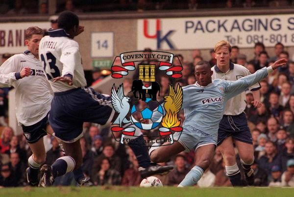 Coventry's Peter Ndlovu clears from Sol Campbell during their Premiership match against Tottenham, at White Hart Lane