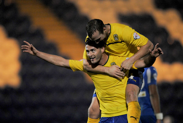Coventry City's Gary Madine celebrates scoring against Colchester United with teamate Andy Webster during the Sky Bet League One match at the Weston Homes Community Stadium, Colchester