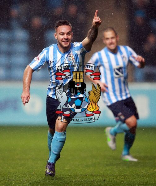 Coventry City's Adam Armstrong celebrates scoring the third goal