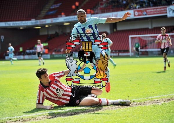 Coventry City's Callum Wilson (right) and Sheffield United's Harry Maguire challenge for the ball