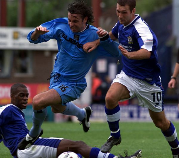 Coventry's new signing Keith O'Neill (centre) skips over a challenge from Stockport's Leo Roget and holds off Scott Taylor during the Nationwide Football League Division One game at Edgeley Park, Stockport